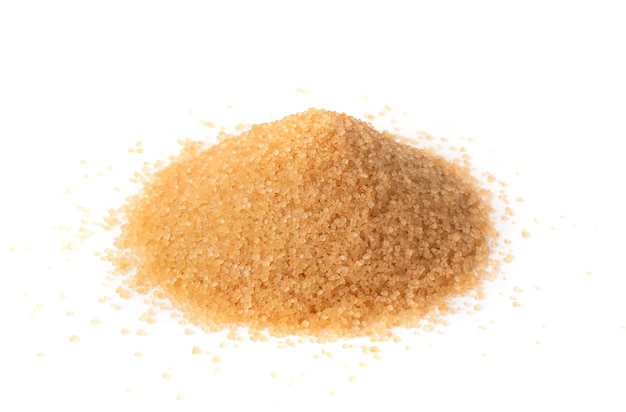 Pile of brown sugar isolated. raw unrefined cane sugar heap side view