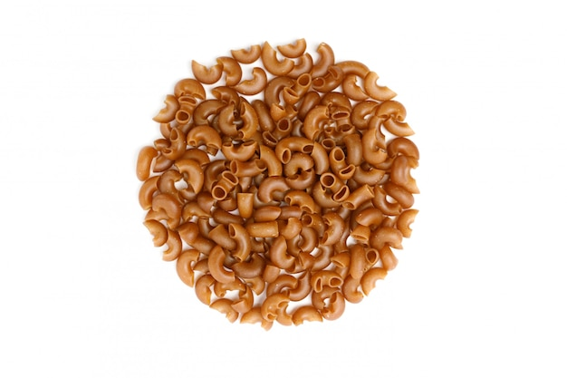 Pile of buckwheat pasta from flour on a white background, top view