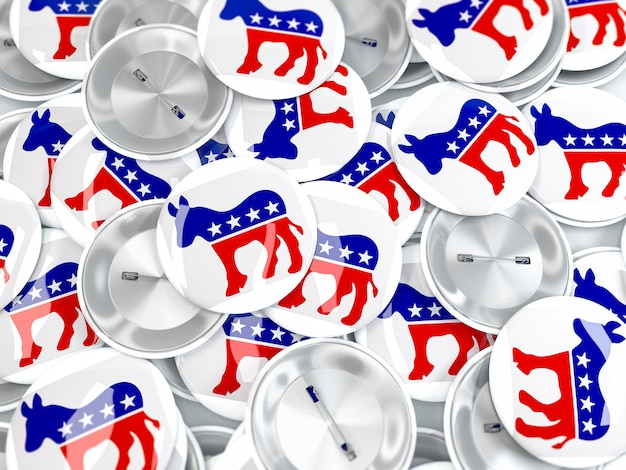 Pile of button badges with donkey. symbol of us democratic party
