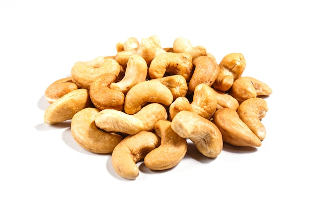 Pile of cashew nuts  isolated on white background.