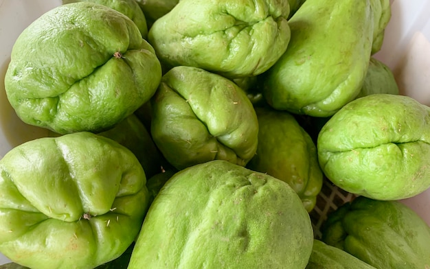 Pile of chayote (sechium edule) on the vegetable market