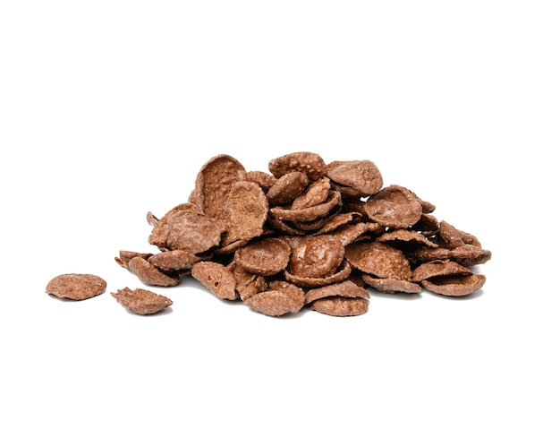Pile of chocolate cornflakes isolated on white background, dry morning breakfast