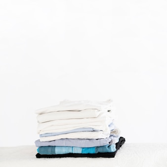 Pile of clean clothes copy space