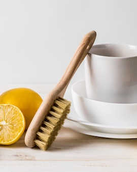 Pile of clean dishes and natural cleaning products