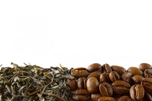 Pile of coffee beans and dry green tea leaves isolated on white background.