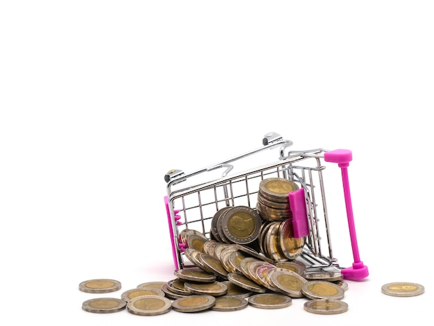 Pile of coin in the shopping cart isolated on white background.