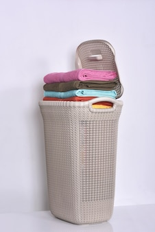 Pile of colored towels in basket