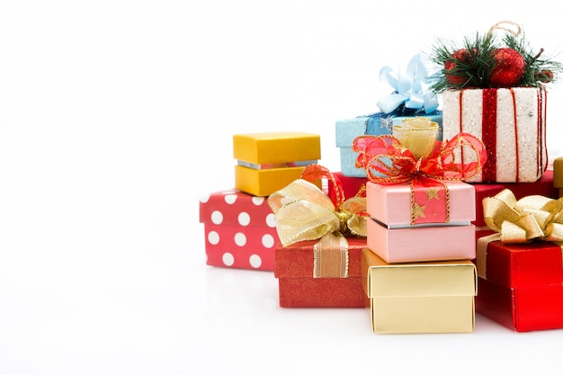 Pile of colorful gift boxes isolated on white