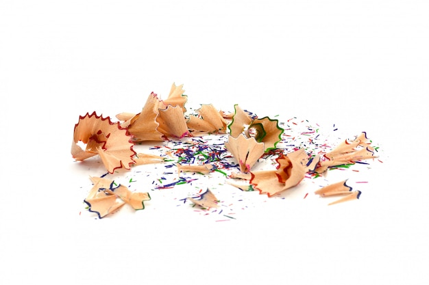 Pile of colorful pencil shavings isolated on a white paper