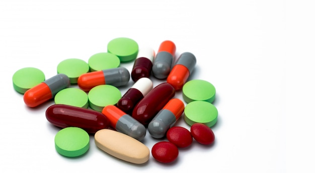 Pile of colorful tablets and capsule pills isolated