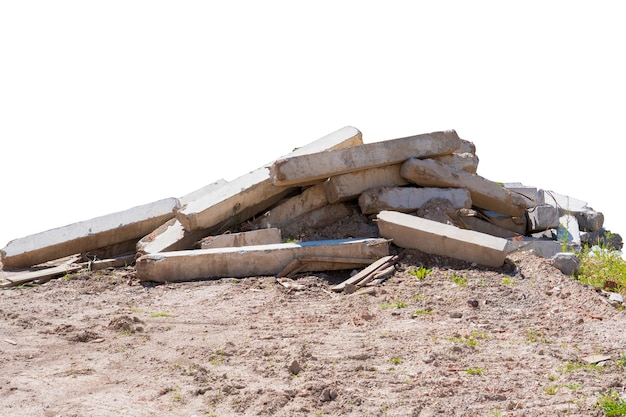A pile of construction debris made of concrete blocks, wood and metal on a white background.
