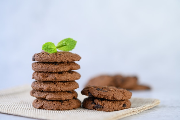 A pile of cookies on a cloth on a wooden table