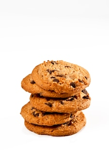 Pile of cookies on white surface isolated