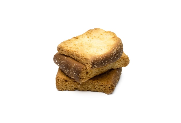 Pile of delicious crispy toast biscuit on isolated white background with selective focus