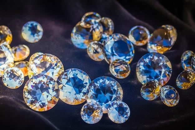 Pile of diamonds on black silk velvet