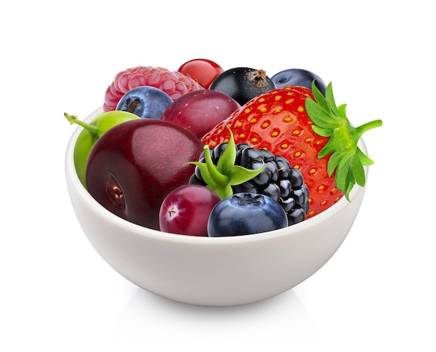 Pile of different forest berries in bowl isolated on white background with clipping path