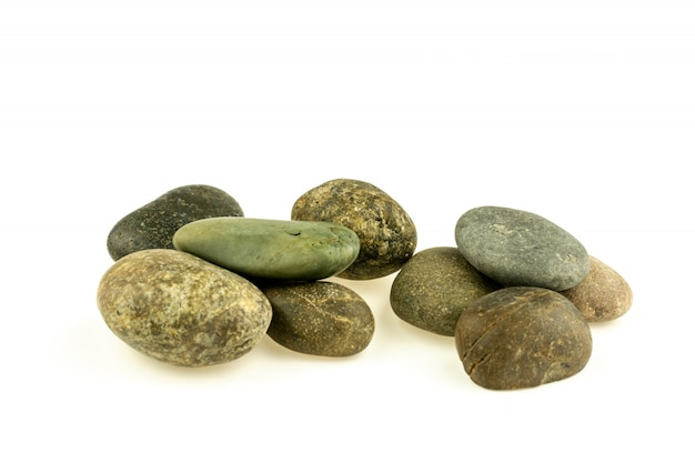 Pile of a different stones and pebbles isolated on white background.