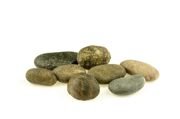 Pile of a different stones and pebbles isolated on white