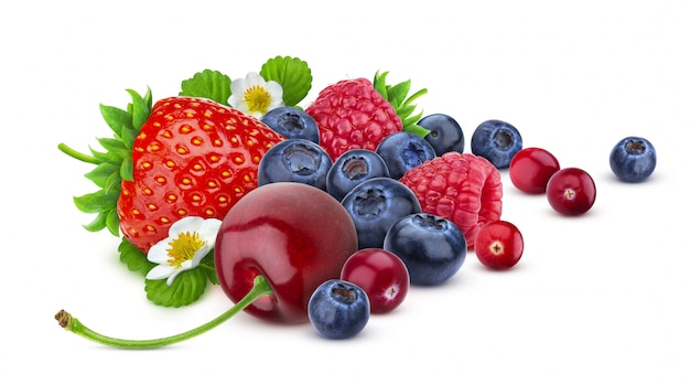 Pile of different wild berries isolated on white background with clipping path.