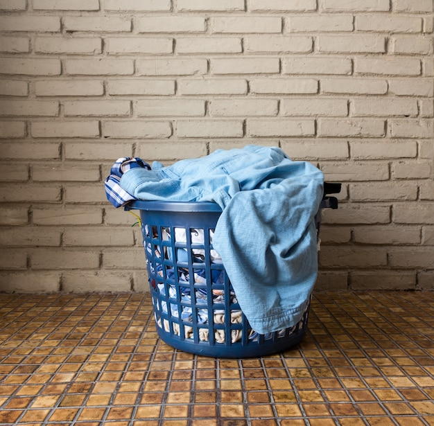 Pile of dirty laundry in a washing basket