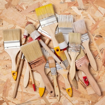 Pile of dirty paint brushes