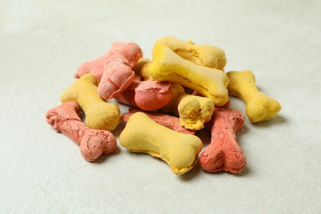 Pile of dog feed on white textured