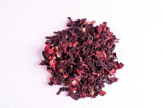 Pile of dry hibiscus karkade herbal tea