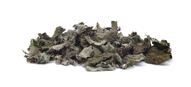 Pile of dry mint leaves isolated on white background