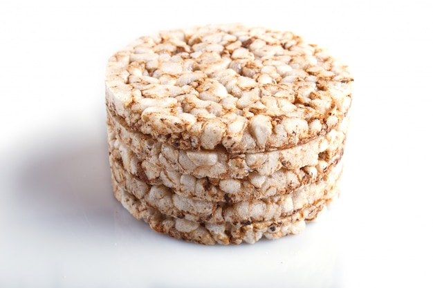 Pile of five rice cakes isolated on white.