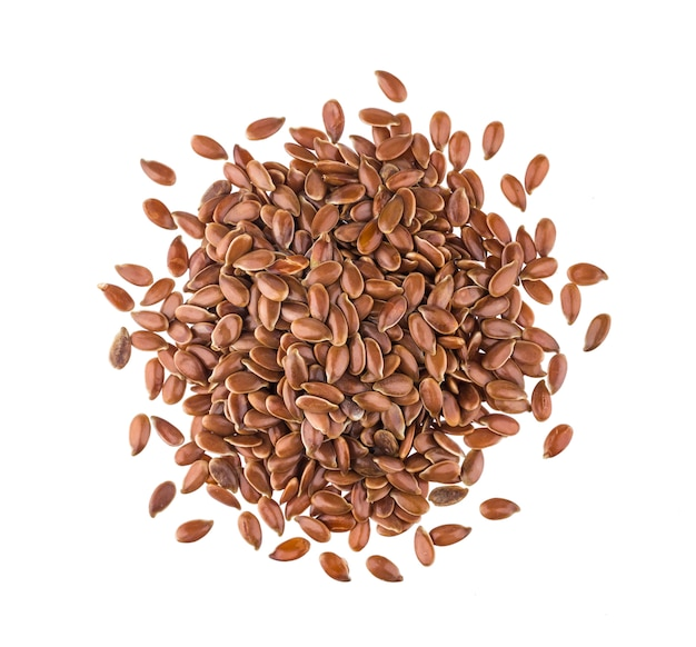 Pile of flax seeds on white , top view