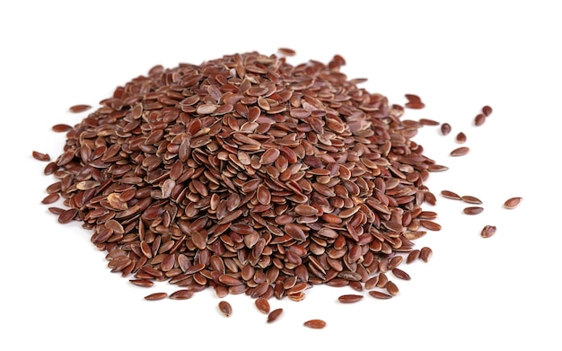 Pile of flax seeds on white