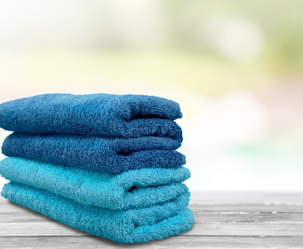 Pile of  fluffy towels on background