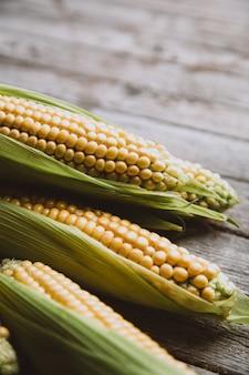 Pile of fresh corn on wood
