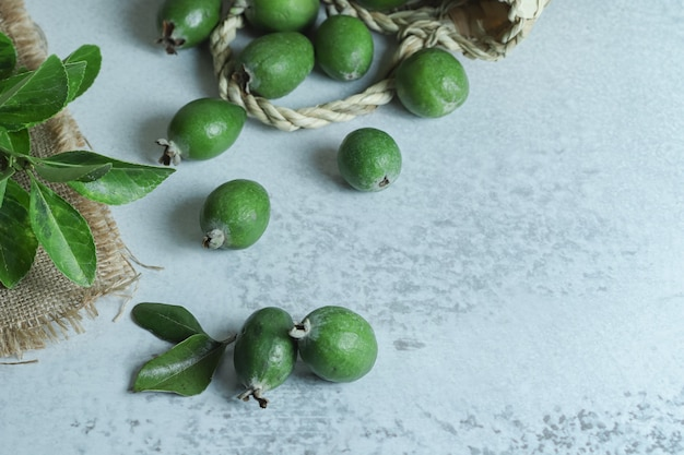Pile of fresh feijoa fruits out of bag.