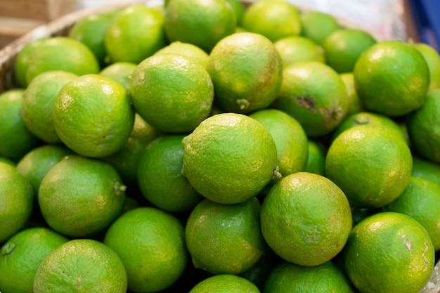 Pile of fresh green lemon lime for sale in the market