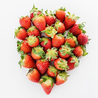 Pile of fresh strawberries top view