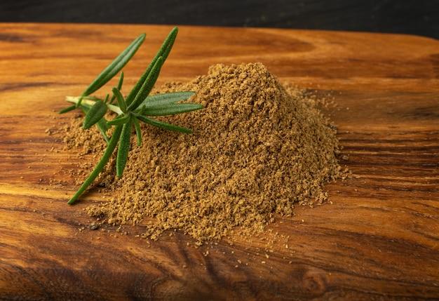 Pile of garam masala powder mix on wood background