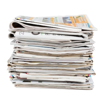 Pile of generic newspapers isolated on white background