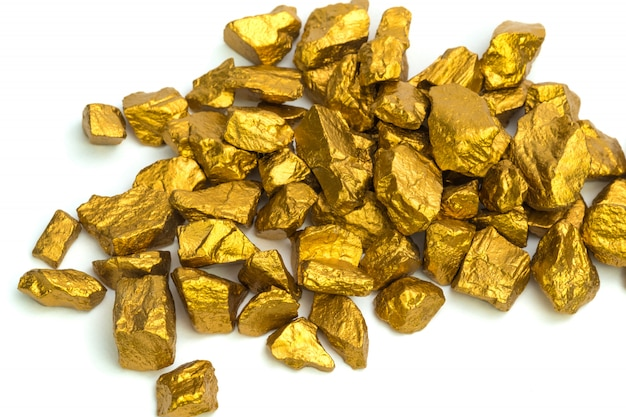 A pile of gold nuggets or gold ore isolated