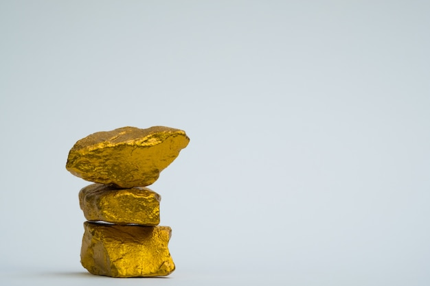 A pile of gold nuggets or gold ore on white background,