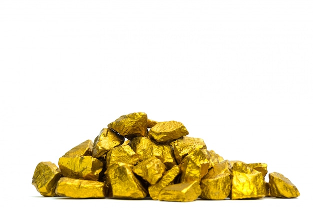 A pile of gold nuggets or gold ore on white