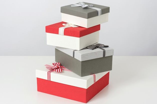 Pile of grey and red gift boxes