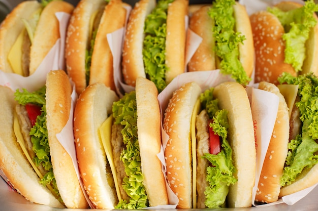 Pile of hamburgers on a tray, ready to be served at the fast food