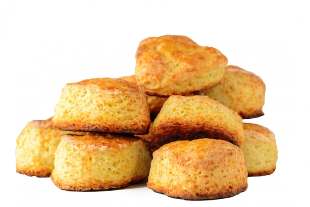 Pile of homemade english cheese buns scones on white background