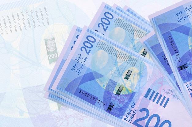 Pile of israeli new shekels bills