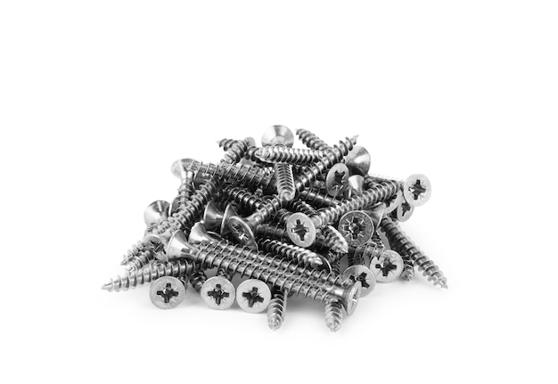 A pile of long wood screws on a white background