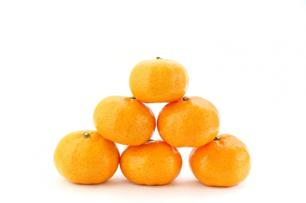 Pile of many orange fruits on white background