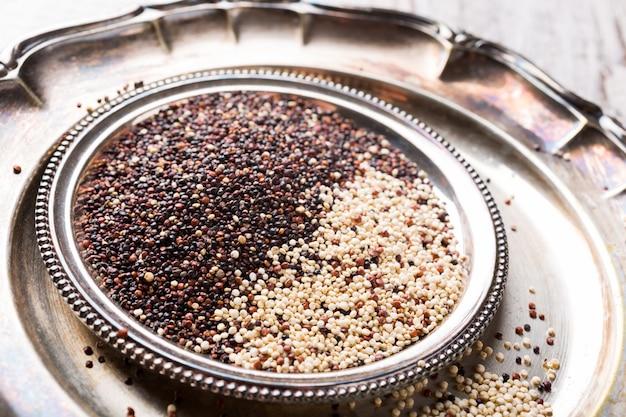 Pile of mixed raw quinoa