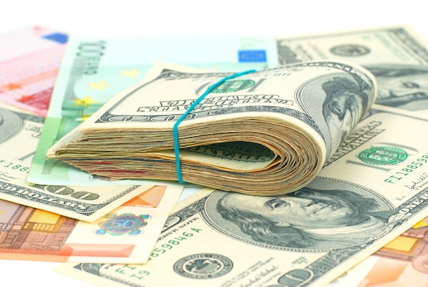 Pile of money cash of us dollars and euros for business background
