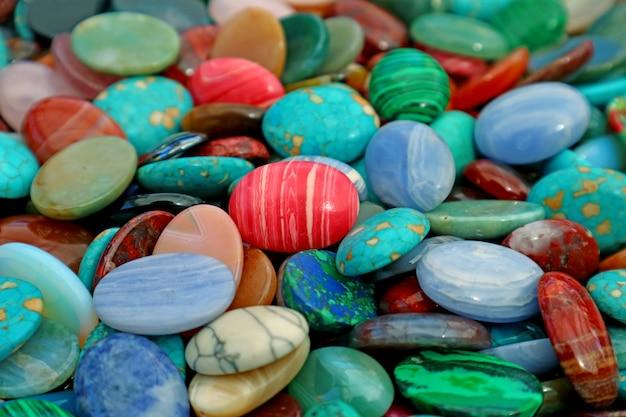 Pile of multi color semi precious stones for background or wallpaper